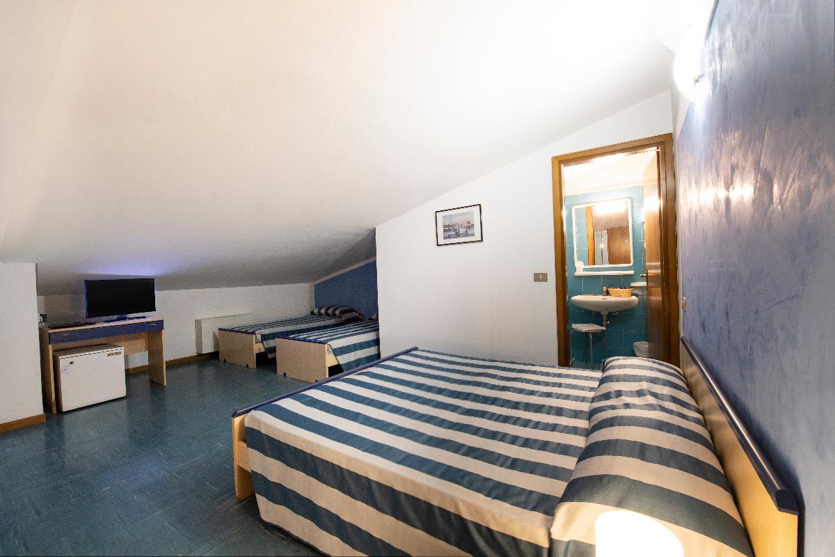 Economy attic quadruple room Hotel Gritti